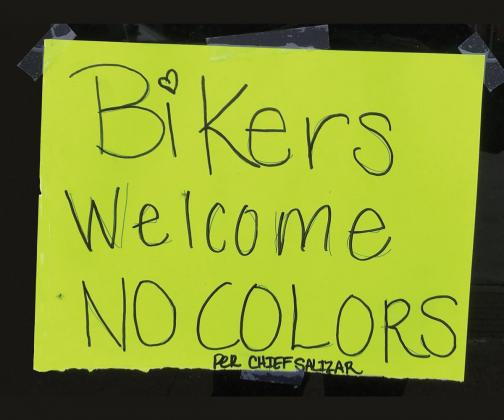 Close-up of the sign posted on the Ferris Bar and Grill front door.