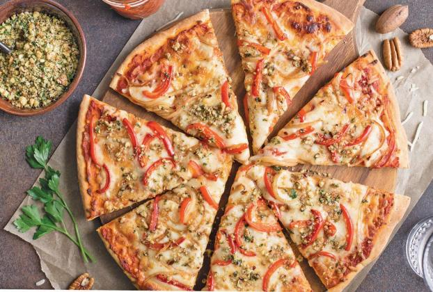 Pizza with pecan-herb topping
