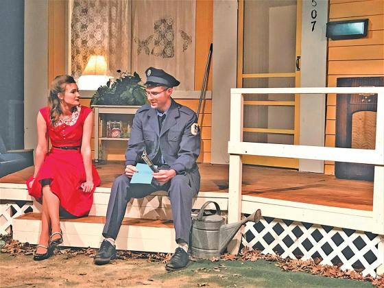 """In """"My First Date,"""" Annastasia Erhard (Cassidy Ann Hortman) is entertained by postman Mr. Walker (Aaron Green), who is confident women love a man in uniform."""