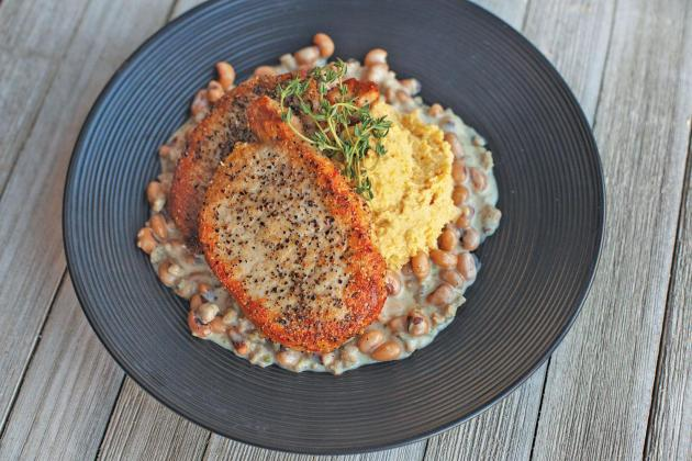 Pork Chops with Smashed Yellow Peas and Black-Eyed Pea Gravy