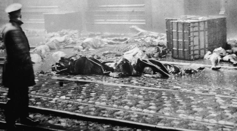 Bodies of factory fire victims, lying on the street, where they struck the pavement after jumping from the burning building.
