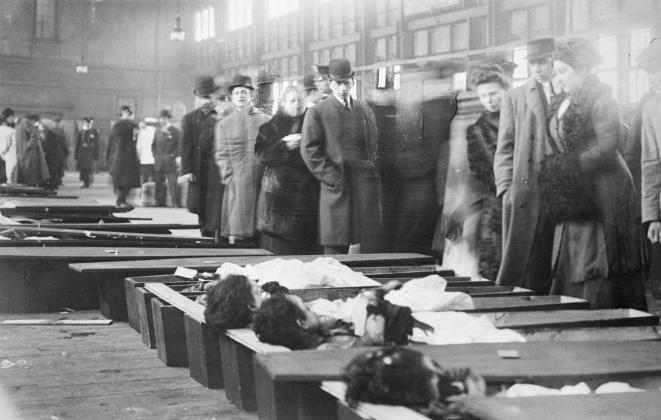 Family members arrive at the New York City morgue to identify the bodies of victims of the Triangle Shirtwaist Company fire.