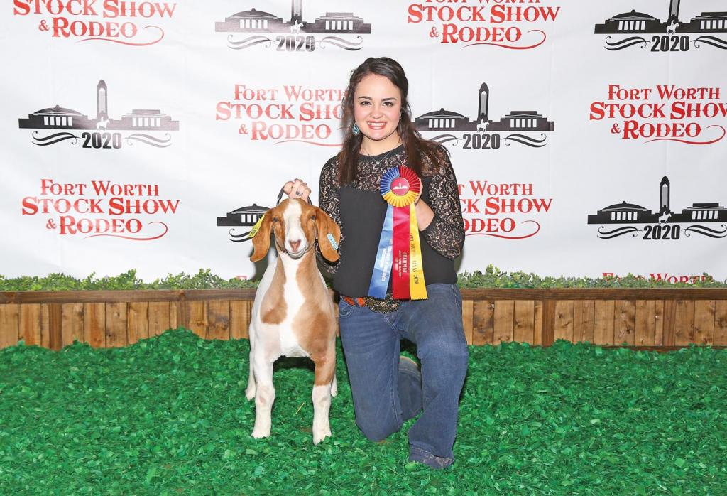 Waxahachie 4H member Kylie Wimbish and her Light Weight Champion Wether Goat.