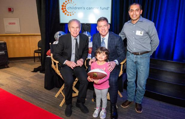 Adiela Tobar and her dad Jesse Tobar meet Honorary Co-Chairs Troy Aikman and Roger Staubach during the autograph session of the photo shoot for this year's gala.