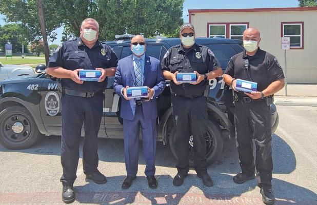 State Representative Carl Sherman, (Dem) District 109 handed out about 50 face masks to Wilmer's Police Chief Victor Kemp last week.
