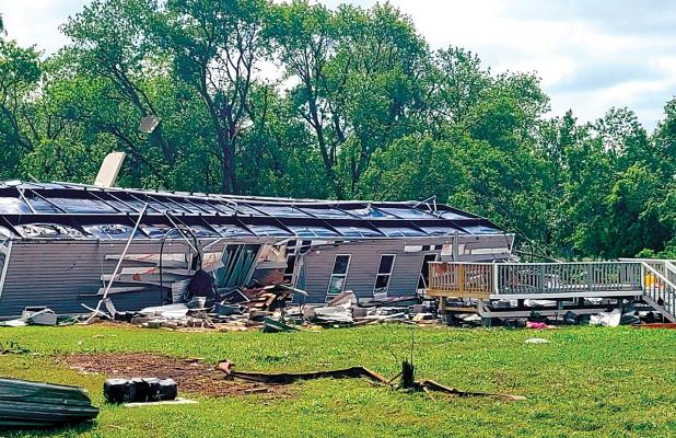 Hail and heavy rain caused widespread damage Monday night in Ellis County. High winds caused two 18-wheelers to overturn on Interstate 35 near Waxahachie. A mobile home was blown over near Forreston, with 14 injuries reported as a result of the storm. Power was lost in several areas around the county.