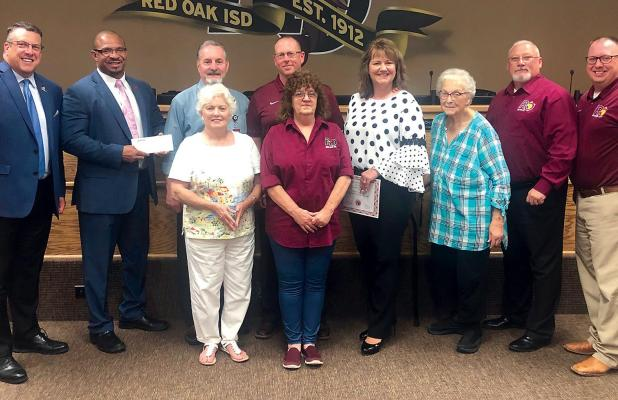 Ginger Kelley, Victron Energy assistant vice president, presented the grant checks to the district at the June 18 school board meeting.