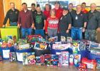 Members of Texas Civil Defense took part in their annual food and clothing drive this past Saturday by collecting the donation bins they distributed in stores and other locations. The collected food and clothes were given to North Ellis County Outreach.