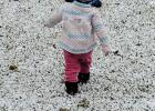 A little girl (unnamed) in Italy takes her first steps in the three-inches of snow that fell Sunday.