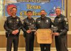 Midlothian Police Department Officer Chris Vinson, with trophy,  returned from Corpus Christi several weeks ago as a two-time second place winner in the Texas Challenge, an event that improves the quality of Texas inspectors and their roadside inspections. He was supported at the competition by Midlothian Sgt. Jordan, Commander Harp and Police Chief Carl Smith.