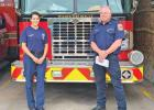 Maria Gabriela Gillen and Wilmer Fire Chief Mark Hamilton are shown after the city hired its first female fire fighter.
